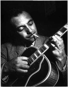 Django Reinhardt, Gypsy guitarist with an unforgettable, unique and spell-binding style~