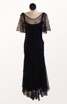 Gorgeous black dot net bias gown with full skirt bottom and flutter sleeve. Designed In: 1930s Made of: embroidered net, nylon Color: black Closure: side snaps Bust: Hip: Please contact us for additio