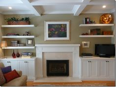 shelves and built ins on either side of the fireplace