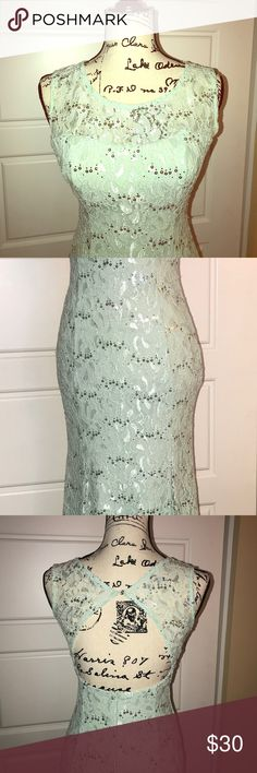 """Formal Prom Dress """"My Michelle"""" Size 5 Formal Prom Dress """"My Michelle"""" Size 5, mint green. Open back, back length is slightly longer.   May need to be cleaned, the longer back is slightly dingy. But otherwise the dress is in great condition. My Michelle Dresses Prom"""