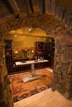Love the stone arch going into the wine cellar. Would love to have one of these in my future home!