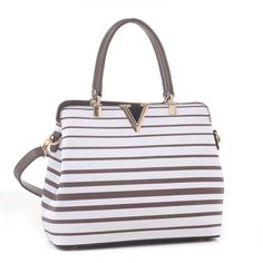 One of our favs this spring fashion tote features: Gold tone hardware Double top handles Back Pocket with Zipper Closure Adjustable/detachable shoulder strap Interior - center divider with zipper po