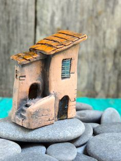from www.thecherryheart.etsy.com  Mini house with stairs- ceramic miniature  for terrariums, gardens, pots and aquariums