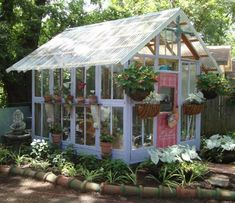 Backyard greenhouse built out of old windows