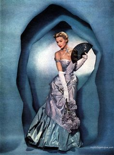"vintage Vogue fashion photography (Love how she looks like she's standing in one of Georgia O'Keefe's ""flowers""...)"