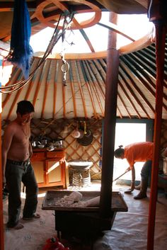 Mongolian Family in the yurt by Alex Yule