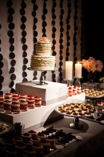 Cake / Dessert Table. I just like how the boxes are used to create height