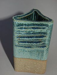 Variegated Slate Blue Ferro Frit 3195 – 20 Wollastonite – 29 Nepheline Syenite – 4 EPK – 30 Silica – 17 Rutile – 6 Copper Carbonate – 3 Cobalt Carbonate – 1.5 An oxidation glaze from Mastering Cone 6 Glazes. Very sensitive to application thickness and temperature. Matte light blue cooler, glossy blue-green hotter