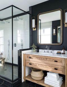 Mix it up. Black and White with wood cabinets in this luxe bathroom.
