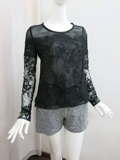 This summer, look chic in this french lace top and tweed shorts ensemble with cool shades and stylish sandals.