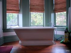 A beautiful bathroom in the city, look at this tub with bay windows!