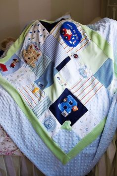 Baby clothes quilt.  Such a cute keepsake!