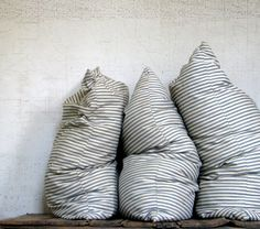ticking pillows - classic farmhouse decor for couches? A Well Traveled Woman, Ticking Stripe, Ticking Fabric, Striped Cushions, Linen Pillows, Feather Pillows, Textiles, Farmhouse Chic, My New Room