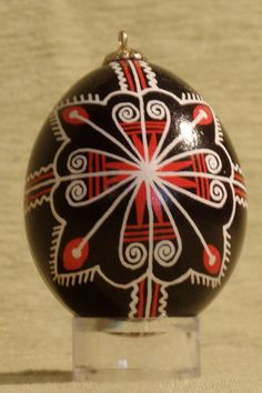 Red and black pysanka with fringe