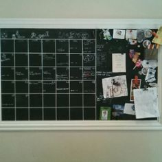 DIY magnetic calendar. Piece of sheet metal, primed, painted with chalkboard paint and the lines are skinny white electric tape. We use Chalk Ink Marker so there is no chalk dust. Oh- we made the frame from cheap molding from Home Depot. We love it!