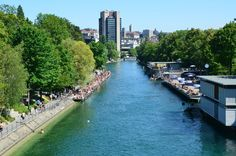 View of Oberer Letten Canal in Limmat River with Zurich city in the background-best rivers in switzerland safe for swimming Zurich, Switzerland, Rivers, Around The Worlds, Europe, Swimming, City, Places, Summer