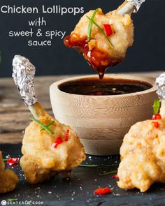 The perfect appetizer, these tender chicken lollipops have a light and crisp batter. They're served with delicious hot, spicy and sweet sauce. So much better than takeout! Chicken Appetizers, Appetizer Recipes, Holiday Appetizers, Savoury Recipes, Chicken Lollipops, Sweet And Spicy Sauce, Party Finger Foods, Chicken Wing Recipes, Game Day Food