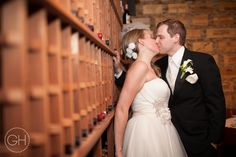 Bride and Groom sneaking a kiss ©Great Heights Photo