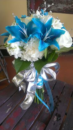 Blue and White Wedding Bouquet...Blue, Silver, White, Sparkley, carnations, stock, lilies, hydrangea, roses