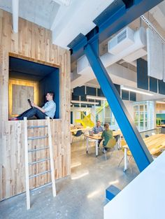 Studio O+A have designed a vibrant and colorful space in San Francisco, for Capital One bank employees to use design thinking to solve manag...