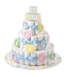 WILTON-Diaper Cake Kit. Create a diaper cake for the baby shower. It is sure to be a hit with the mom-to-be and all the guests. This package contains one base with a 16 inch diameter, three ribbons (5