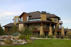 Outside picture Plan W9520RW: Craftsman, Mountain, Photo Gallery, Luxury, Corner Lot, Sloping Lot, European, Premium Collection House Plans & Home Designs