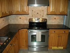Kitchen Backsplash Granite pictures of st. cecilia granite with white cabinets | kitchen