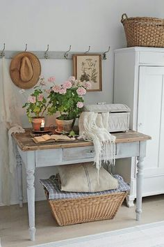 Simple vignette with a farm table, some hooks and decor