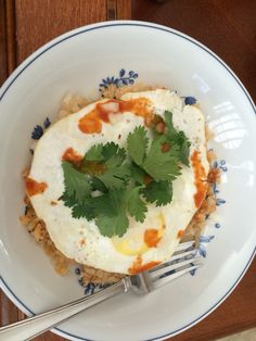 Spanish rice tipped with a fried egg, sprinkled with onions, cilantro, and Tapatio hot sauce. Eaten with corn tortillas. Yum!