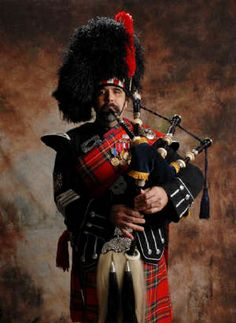 Red Royal Stewart Tartan ~ Full Regimental Uniform with Milirary Decorations and Weaponry.