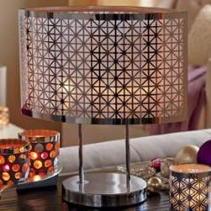 """Enchanted Silver Votive Lamp - Striking photo-etched shade casts a stunning glow when lit by votives or tealights, sold separately. Metal frame with two glass votive cups. 14"""" h, 12 3/4"""" w. Price:  $95.00 each"""