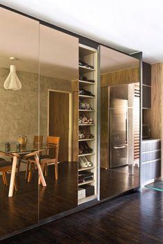 Shoe cabinet - Adjustable shelves behind the mirrored doors offer versatile storage