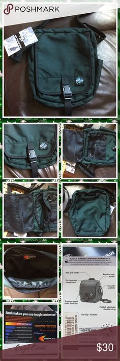 """Eagle Creek travel gear Dark green small bag padded and adjustable shoulder strap size 12"""" x 8-1/2"""" x 3"""" details please see third photo NWT eagle creek Bags Travel Bags"""