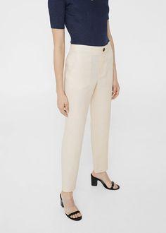 Tejido de lino Corte recto Cintura elástica Dos bolsillos laterales Forro interior Cierre de cremallera y botón