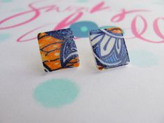 Handmade African wax fabric style shrink plastic earring studs in blue and orange.