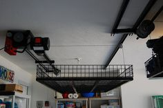 Amazon.com: Ceiling Storage Lift Raises 500 Pounds of Your Items to Ceiling of Garage, Huge Space Saver, No Ladder Needed, Raises to 16 Feet, Powered by Strong Electric Motor, Durable Steel Construction: Home & Kitchen