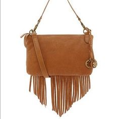Lucky brand fringe purse 3 pocket lucky brand small purse. Has long strap and short strap. Slightly worn spot on front and small stain on one fringe (noted in pictures) love this purse! Lucky Brand Bags
