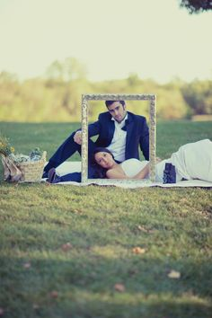I don't like this pose but i do like the idea of taking wedding pictures with a big frame!