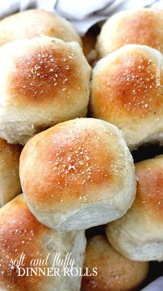 Perfect Soft and Fluffy Dinner Rolls - NO HAND KNEADING! double brushed with butter and topped with garlic salt. I will never make another roll recipe again!