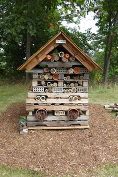 Pollinator Palace at Shadbush Teaching Gardens located in River Bends Park, 22 Mile Rd, Shelby Twp, MI. Beyond planting gardens with plants favored by pollinators such as butterflies and bees, there are other ways to provide safe habitats for these beneficial insects--including constructing 'pollinator palaces' made from leftover building materials and natural materials found in your yard. Pollinators need homes near flowering plants where they can nest, hibernate and hide from predators.