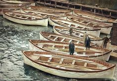 Beautiful and sad colored photo of RMS Titanic lifeboats in New York at White Star Pier 59 after being dropped off by RMS Carpathia.