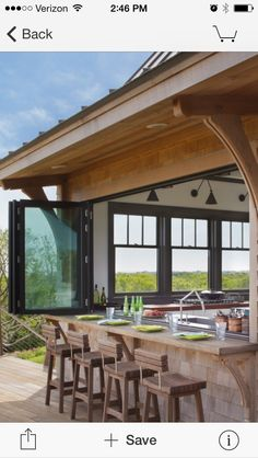 I love this accordion style window and bar seating!!