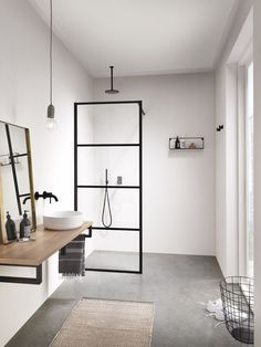 Monochrome bathroom with crittall-style shower surround