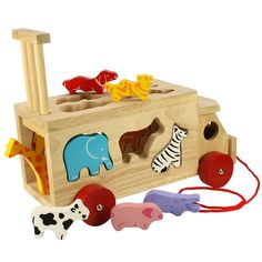 This lovely lorry has a dual function and will keep curious minds occupied for hours! Children will love to push the different animals through the right holes and then retrieve them by lifting up the grille at the back. They will also enjoy pulling it along on its cheerful red wheels, using the attached cord. A superb item which will endure as children grow and grow.