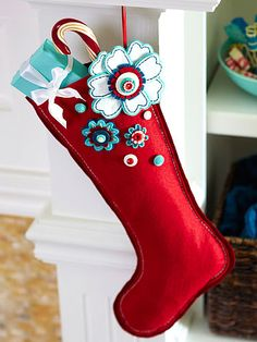 Flowered Felt Stocking @Better Homes and Gardens: Add a modern twist to a yuletide favorite by scattering happy-hue blooms and shank buttons over a felt stocking