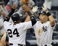 GAME 151: Saturday, Sept. 22, 2012 - New York Yankees' Raul Ibanez, right, celebrates with Robinson Cano after Ibanez homered during the 13th inning of a baseball game against the Oakland Athletics at Yankee Stadium in New York. The Yankees defeated the Athletics 10-9 in 14 innings.