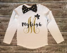 A personal favorite from my Etsy shop https://www.etsy.com/listing/250100133/girls-sparkle-shirt-monogram-letter