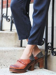 Raleigh Clog | Wooden heeled clog featuring a braided leather trim and a soft suede back.   *By Free People