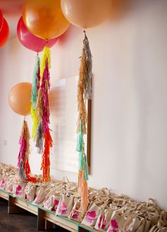 balloons w/ frilly things hanging as the string!