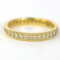 Custom, classic pave Diamond Eternity band. 18k yellow gold ring with 0.53 ctw in diamonds. Custom wedding ring by Abby Sparks Jewelry, custom jewelry designer in Denver, Colorado.